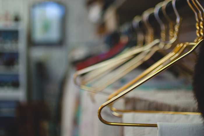 A row of hangers with clothes
