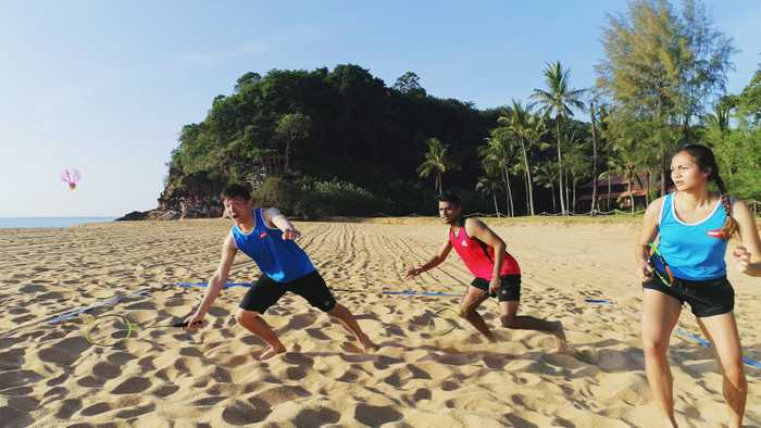People enjoying AirBadminton on sand